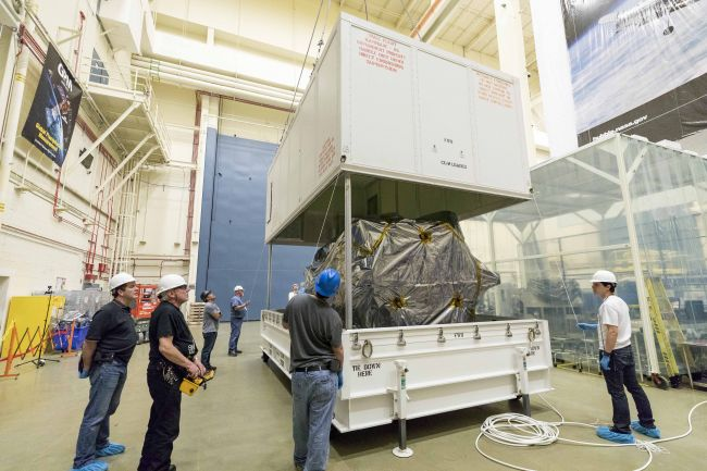 Parker Solar Probe – wrapped in protective plastic – is shown on March 29, 2018, as the lid is lowered onto its shipping container at NASA's Goddard Space Flight Center in Greenbelt, Maryland. The spacecraft is shipped on its side to allow for more easy transport and to avoid height-related obstacles such as bridges. From Goddard, the probe was taken by truck to Joint Base Andrews in Maryland and flown to Florida aboard a United States Air Force C-17.