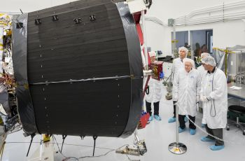 Eugene Parker, professor emeritus at the University of Chicago, visits the spacecraft that bears his name, NASA's Parker Solar Probe, at the Johns Hopkins Applied Physics Laboratory in Laurel, Maryland, where the probe was designed and is being built. The large black structure is one of the spacecraft's massive cooling radiators. The spacecraft is humanity's first mission to a star – it will travel directly through the Sun's atmosphere.