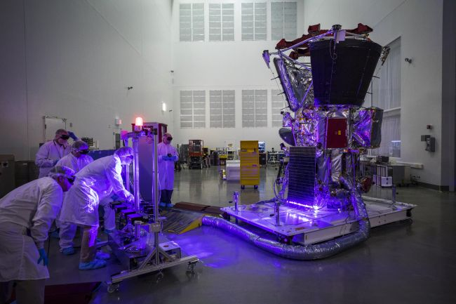 Parker Solar Probe team members use lasers to ensure that the spacecraft's solar arrays have survived harsh environmental testing and are operating correctly.