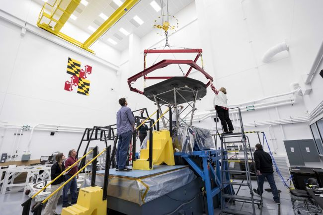 The Parker Solar Probe team at Johns Hopkins APL prepares to lift the heat shield, called the Thermal Protection System (TPS), in preparation for shipment to NASA's Goddard Space Flight Center for further environmental testing.