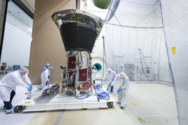 Members of the integration and testing team roll Parker Solar Probe into the Acoustic Test Chamber at NASA's Goddard Space Flight Center in Greenbelt, Maryland.