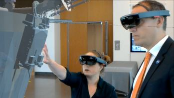 Johns Hopkins APL's Betsy Congdon (left) and NASA's Thomas Zurbuchen, head of the agency's Science Mission Directorate, at the Parker Solar Probe renaming event at the University of Chicago in May. The augmented reality spacecraft model is visible at left.