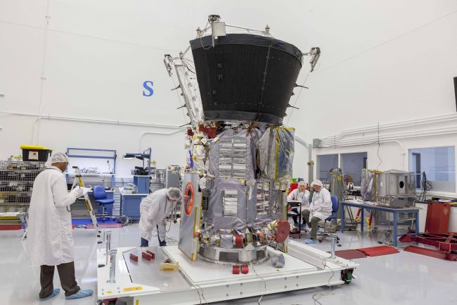 Engineers and technicians prepare the Parker Solar Probe spacecraft for mass properties testing. This marks the beginning of environmental testing, a series of physical tests that will ensure the probe can withstand the rigors of launch and temperature fluctuations of space operations.