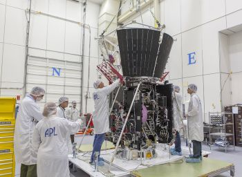 Mission integration and test team members secure the deck holding the structure assembly and several other critical thermal-protection components atop NASA's Solar Probe Plus spacecraft body on April 5, 2017, in the cleanroom at the Johns Hopkins University Applied Physics Laboratory in Laurel, Maryland.